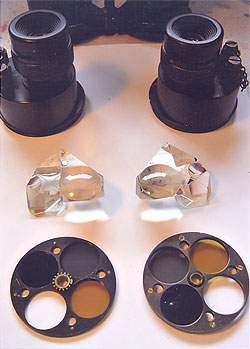 Illustrated are the prism boxes, with eyepieces, prism/field lens units and filter wheels from a CF41 binocular